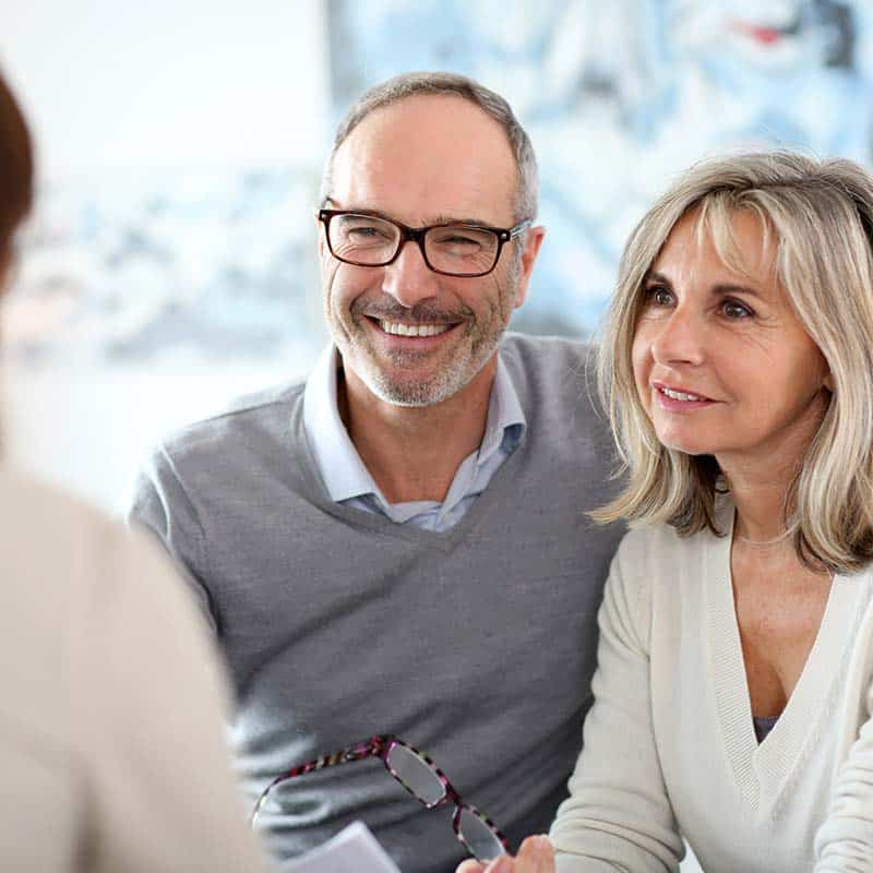 Senior couple meeting health adviser-